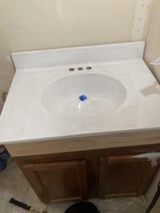 bathroom sink resurfaced / painted with rustoleum, after first coat
