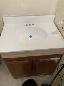 bathroom sink resurfaced / painted with rustoleum tub and tile, after second coat